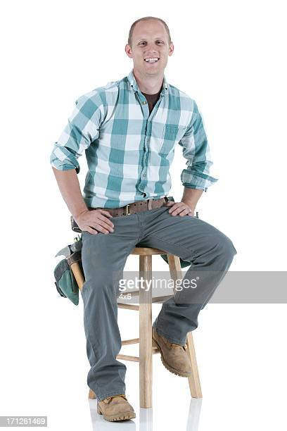 Carpenter sitting on a stool
