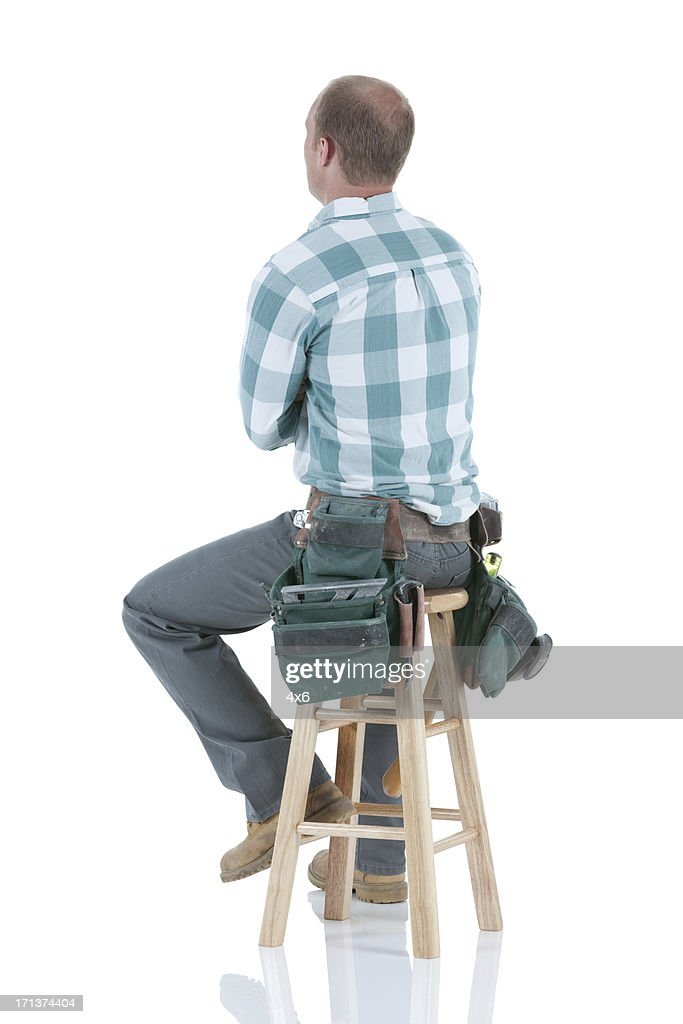 Carpenter sitting on a stool