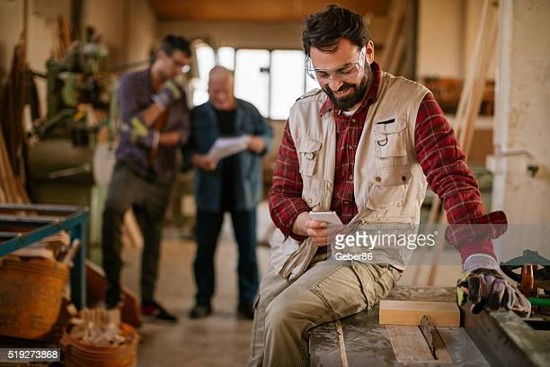 Carpenter texting while working