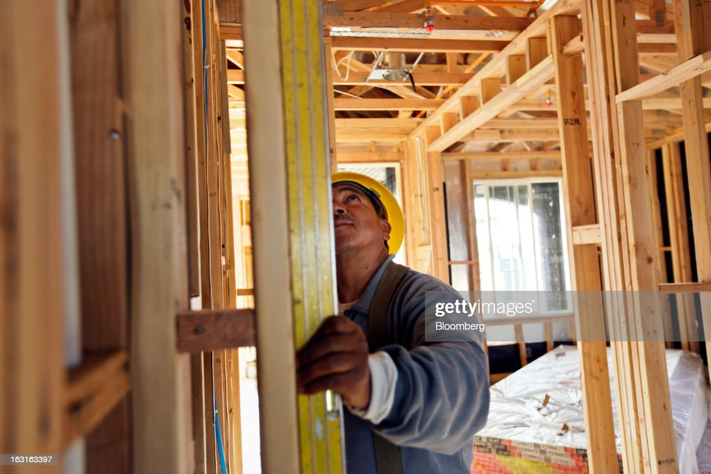 A carpenter uses a level while working on a home under construction at the Hovnanian Enterprises Inc.'s Four Seasons housing development in Beaumont, California, U.S., on Monday, March 4, 2013. Hovnanian Enterprises Inc., the best-performing U.S. homebuilder stock in 2012, is scheduled to announce quarterly earnings data on March 6. Photographer: Patrick T. Fallon/Bloomberg via Getty Images