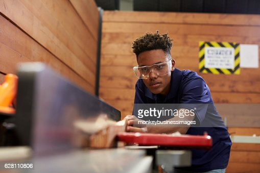Carpenter Using Plane In Woodworking Woodshop : Foto de stock
