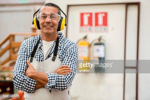Carpenter wearing protective workwear