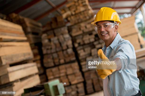 Carpenter with thumbs up at the carpentry