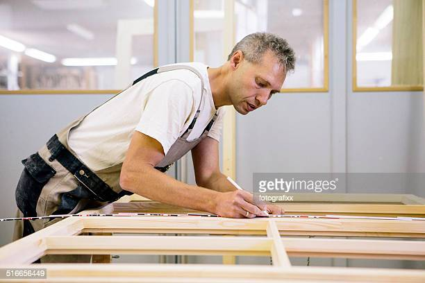 Carpenter working at a window frame