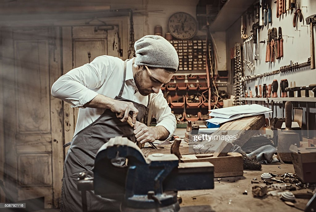 Carpenter working in his workshop : Stock Photo