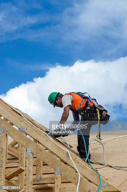 Carpenter working on a roof in Vail, Colorado