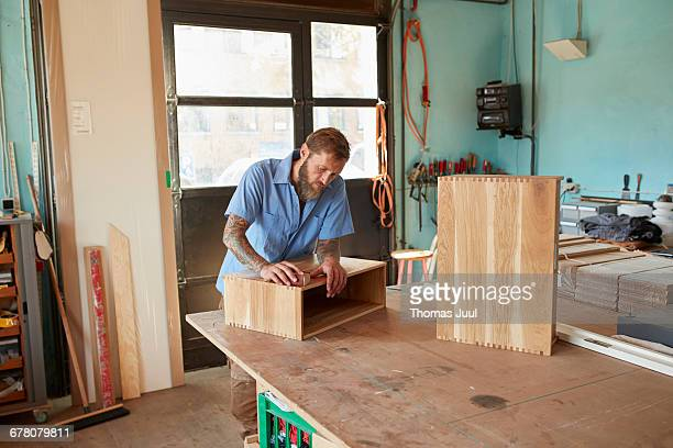 Carpenter working with wood and design