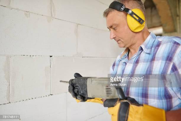 Carpenter works at his workshop. Debica, Poland