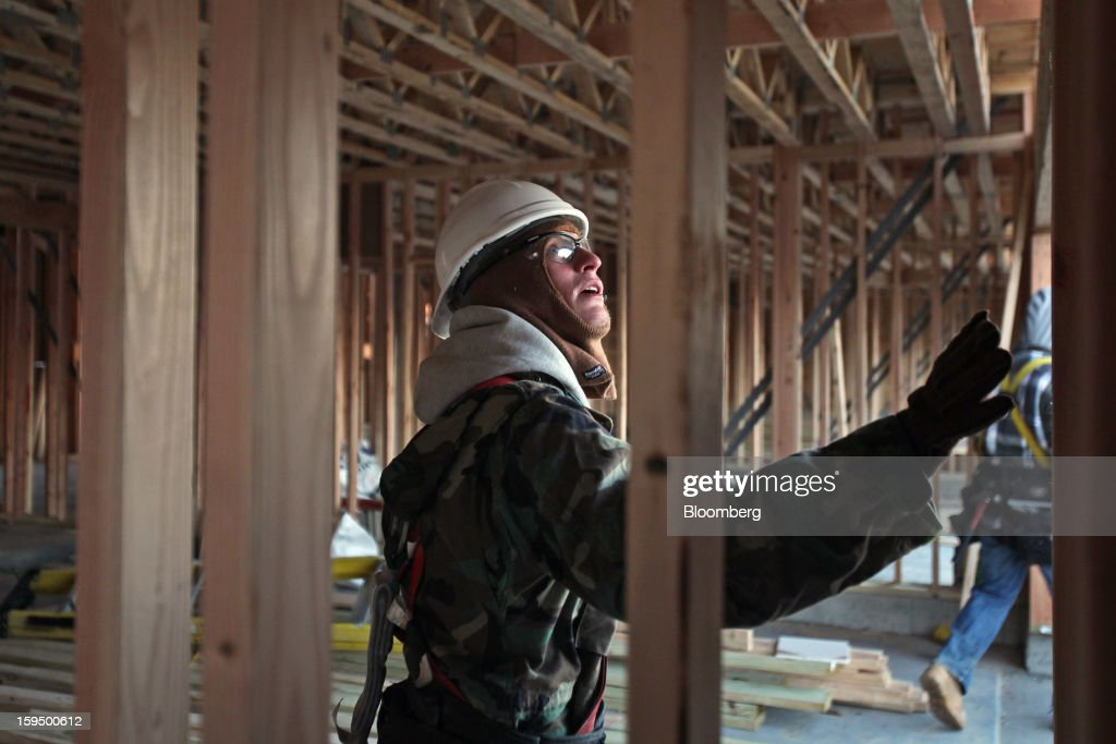 A carpenter works on a new Lexington Homes LLC townhome under construction in Des Plaines, Illinois, U.S., on Monday, Jan. 14, 2013. The U.S. Census Bureau is scheduled to release housing starts figures on Jan. 17. Photographer: Tim Boyle/Bloomberg via Getty Images