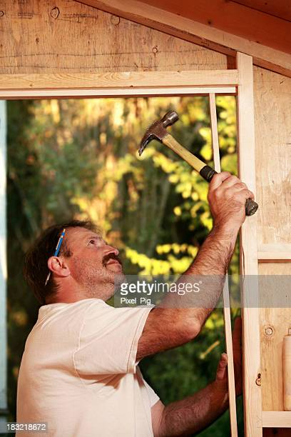 Carpenter works on Outdoor Shed