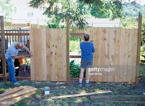 Carpenters Building a Fence