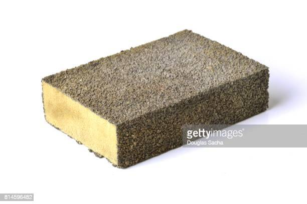 Carpenters sanding sponge block on a white background
