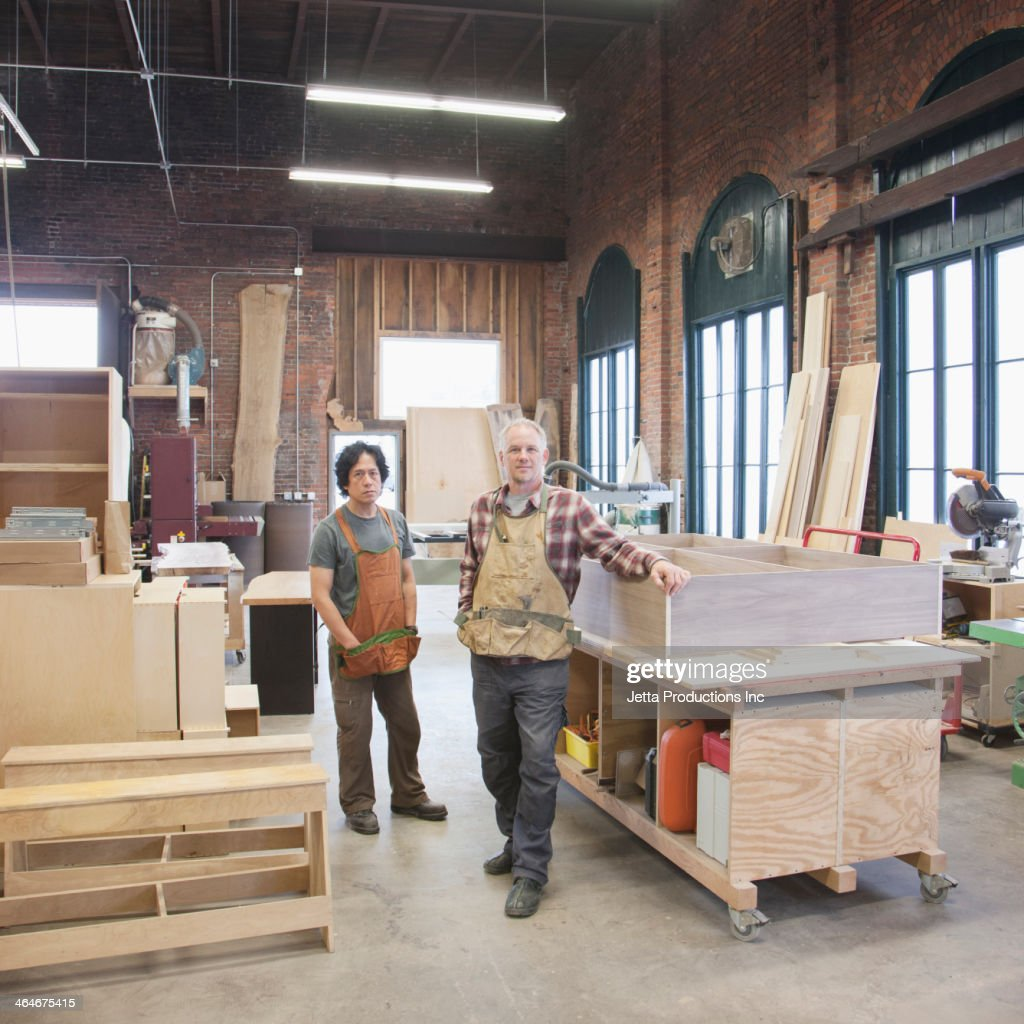 Carpenters standing in workshop : Stock Photo