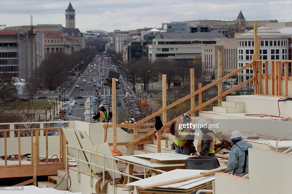 Carpenters work on the platform being built on the west front of the U.S. Capitol in preparation for the inauguration ceremony of U.S. President Barack Obama in Washington, D.C., U.S., on Tuesday, Dec. 11, 2012. The presidential inauguration ceremony will take place on Jan. 21, 2013. Photographer: Andrew Harrer/Bloomberg via Getty Images