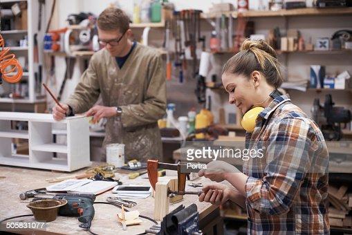 Carpenters working in workshop