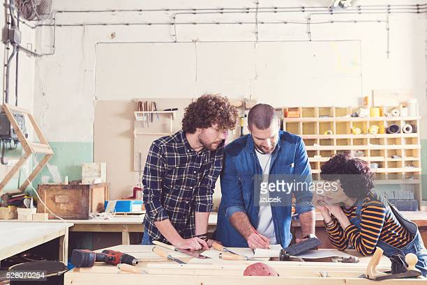 Carpenters working together in a construction workshop