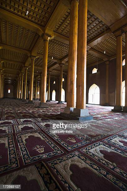 Carpet and columns inside of the Jamia Masjid, Srinagar, Jammu And Kashmir, India