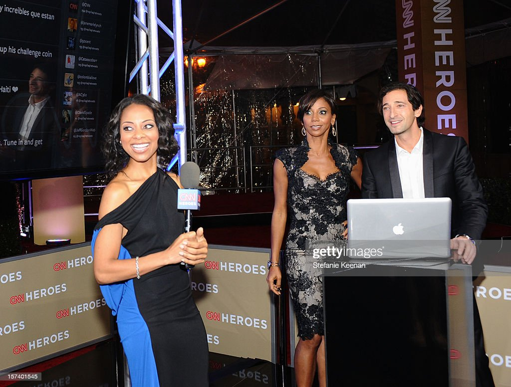 Carpet hostess Nischelle Turner, actress Holly Robinson Peete, and Adrien Brody attend the CNN Heroes: An All Star Tribute at The Shrine Auditorium on December 2, 2012 in Los Angeles, California. 23046_004_SK_0743.JPG