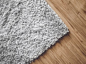 a carpet on parquet floor