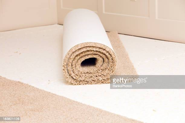 Carpet Roll on Pad in Bedroom Awaiting Installation