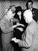 Film comedian Charles Chaplin is shown as he places the ring on the finger of 18 year old Oona O'Neill daughter of Eugene O'Neill foremost American...