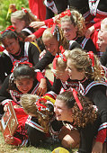 Carpinteria High School cheerleaders pile up on one another after taking first place at the cheerleading competition at the Ventura County Fair
