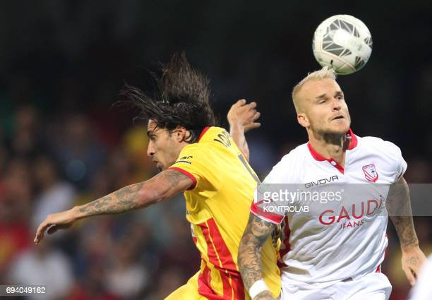 STADIUM BENEVENTO CAMPANIA ITALY Carpi's Slovenian defender Aljaz Struna fights for the ball with Benevento's Uruguayan defender Walter Lopez during...