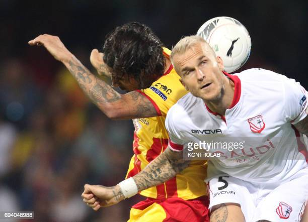 STADIUM BENEVENTO CAMPANIA ITALY Carpi's Slovenian defender Aljaz Struna heads the ball during the Italian Serie B Play Off football match for the...