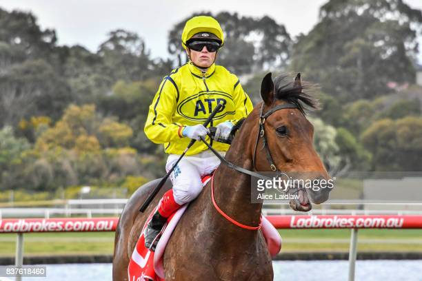 Carraig Aonair ridden by Craig Williams returns to scale after winning the Win a Car at Highways Handicap at Ladbrokes Park Hillside Racecourse on...