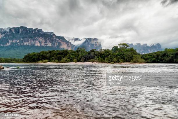 Carrao river at Orquidea island and Auyan-tepui. Canaima National Park