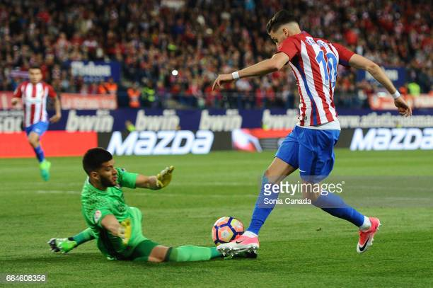 Carrasco #10 of Atletico de Madrid and Geronimo Rulli #1 of Real Sociedad during The La Liga match between Club Atletico de Madrid v Real Sociedad de...