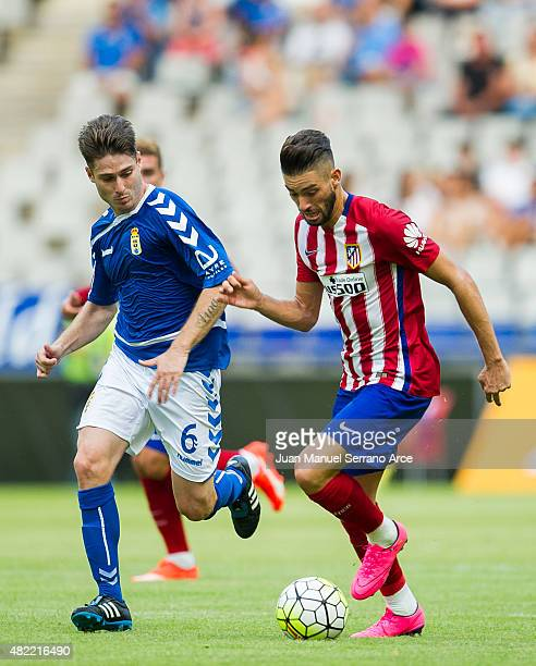 Carrasco of Club Atletico de Madrid duels for the ball with Susaeta of Real Oviedo during a pre season friendly match between Real Oviedo and Club...