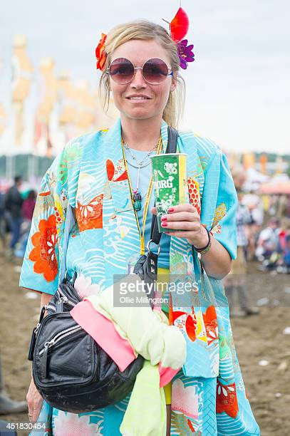 Carren a 33 year old artist from London wearing a made to measure Silk kimono from a market tailor in Tokyo on the 3rd day of the Glastonbury...