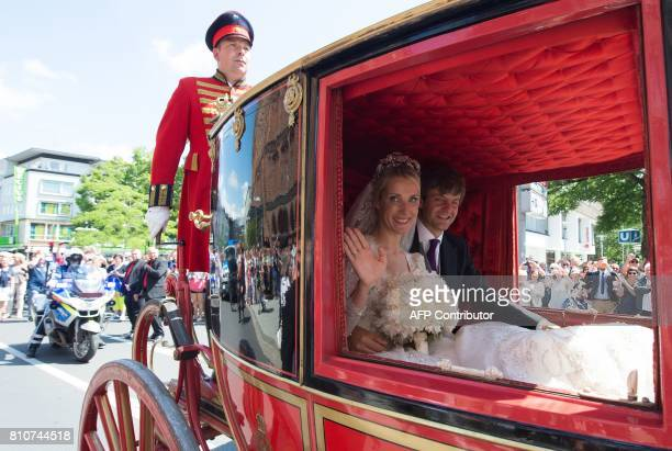A carriage carrying Ekaterina of Hanover and Prince Ernst August of Hanover makes its way through Hanover after their church wedding ceremony in...