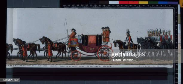 A carriage containing the Duchesses of Kent Gloucester and Cambridge followed by a group of Life Guards on horseback closes the funeral procession of...