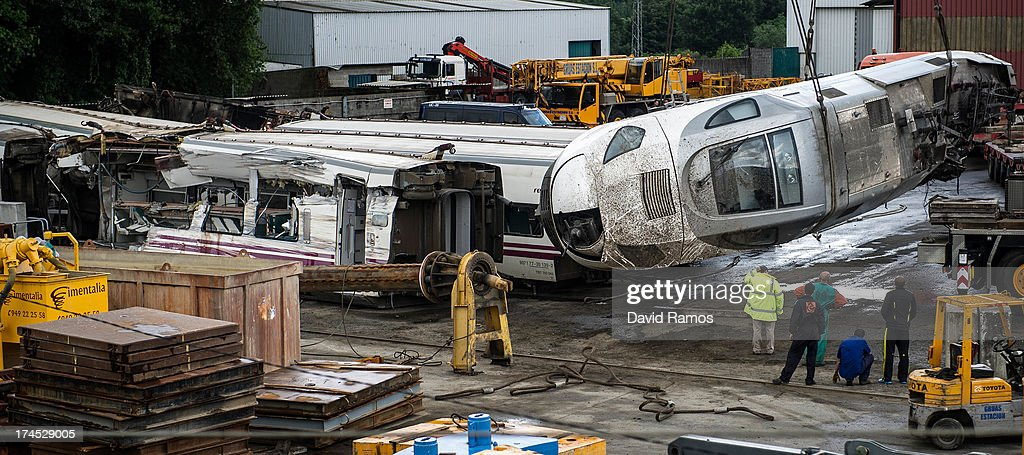 Carriages and train engine are stored in a warehouse in Escravitude, 20 km from Santiago de Compostela after a train crash killed 78 on July 27, 2013 in Santiago de Compostela, Spain. The crash occurred as the train approached the north-western Spanish city of Santiago de Compostela at 8.40pm on July 24th, at least 78 people have died and a further 131 reported injured. The crash occurred on the eve of the Santiago de Compostela Festivities.