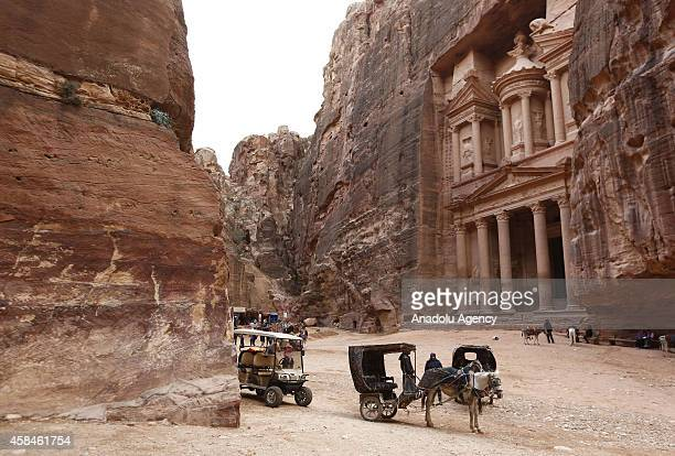 Carriages are seen in front of the facade of Al Khazneh built as a royal tomb and so called after a legend that pirates hid their loot in an urn...
