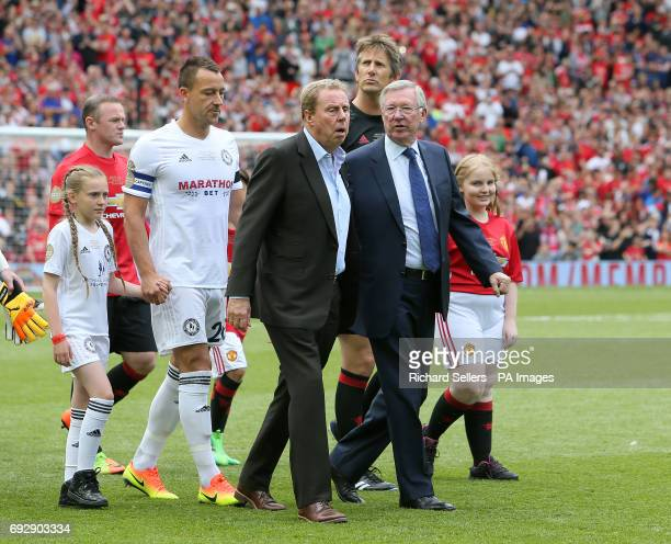 Carrick All Stars manager Harry Redknapp and Manchester United 2008 XI manager Sir Alex Ferguson lead out the teams before the match