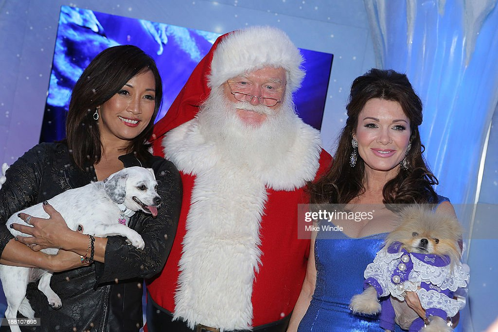 Carrie Ann Inaba and her dog Lola and Lisa Vanderpump and her dog Giggy attend the Beverly Center's Holiday Pet Portraits Debut at The Beverly Center at The Beverly Center on November 14, 2013 in Los Angeles, California.