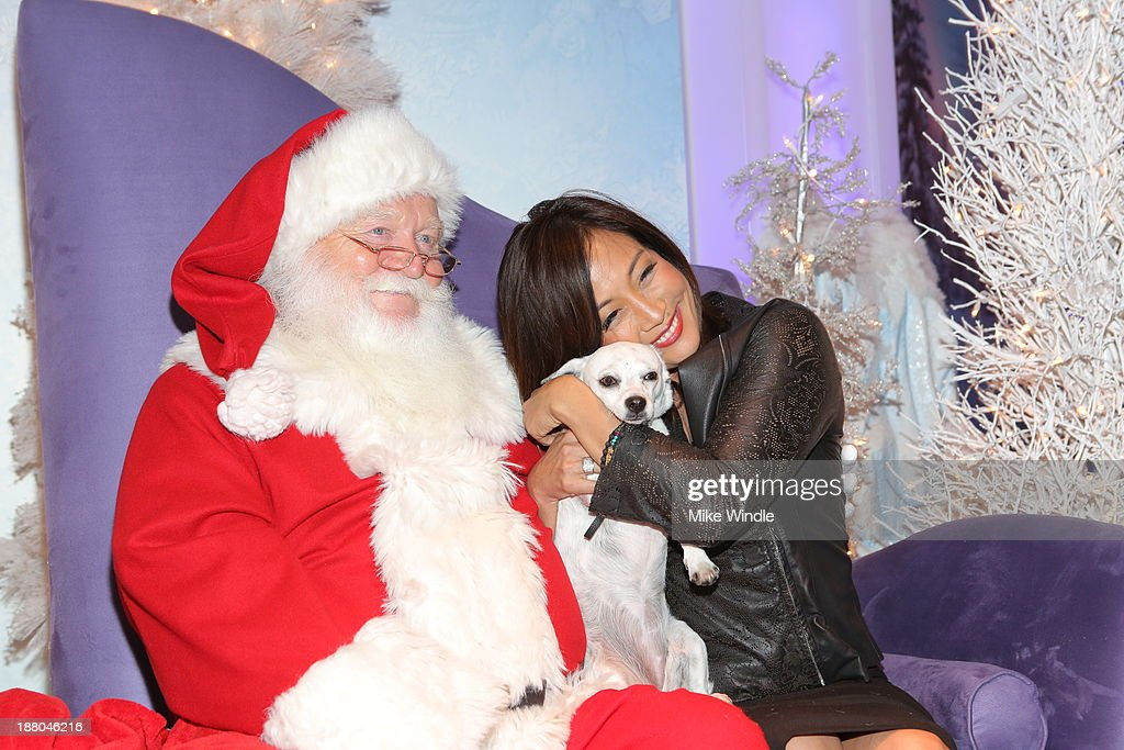 <a gi-track='captionPersonalityLinkClicked' href=/galleries/search?phrase=Carrie+Ann+Inaba&family=editorial&specificpeople=637379 ng-click='$event.stopPropagation()'>Carrie Ann Inaba</a> and her dog Lola attend Beverly Center's Holiday Pet Portraits Debut at The Beverly Center on November 14, 2013 in Los Angeles, California.