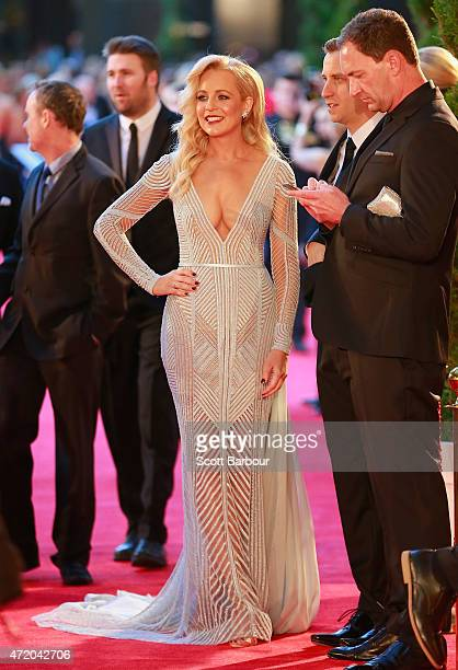 Carrie Bickmore and Chris Walker arrive at the 57th Annual Logie Awards at Crown Palladium on May 3 2015 in Melbourne Australia