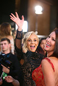 Carrie Bickmore waves as she arrives at the 58th Annual Logie Awards at Crown Palladium on May 8 2016 in Melbourne Australia