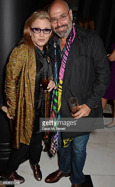 Carrie Fisher and Abe Gurko attend a cocktail party hosted by Helen Fielding celebrating the millionth copy of her book 'Bridget Jones Mad About The...