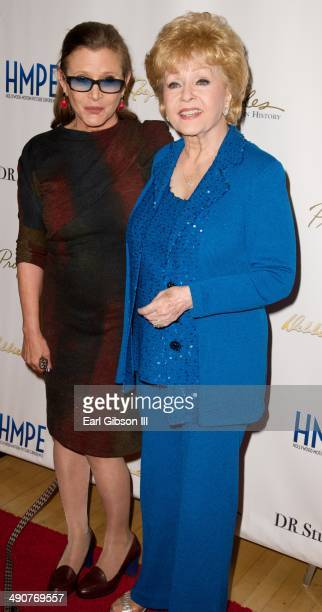 Carrie Fisher and Debbie Reynolds attend the press preview reception for her final Hollywood Motion Picture Collection Auction at Debbie Reynolds's...