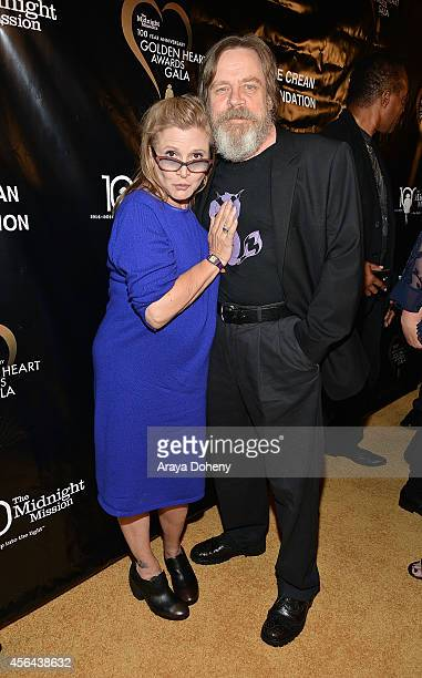 Carrie Fisher and Mark Hamill attend the Midnight Mission's 100 year anniversary Golden Heart Gala held at the Beverly Wilshire Four Seasons Hotel on...