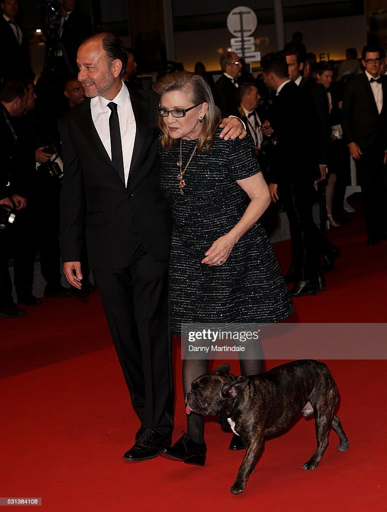 Carrie Fisher, her dog Gary and Fisher Stevens attend 'The Handmaiden (Mademoiselle)' premiere during the 69th annual Cannes Film Festival at the Palais des Festivals on May 14, 2016 in Cannes, France.