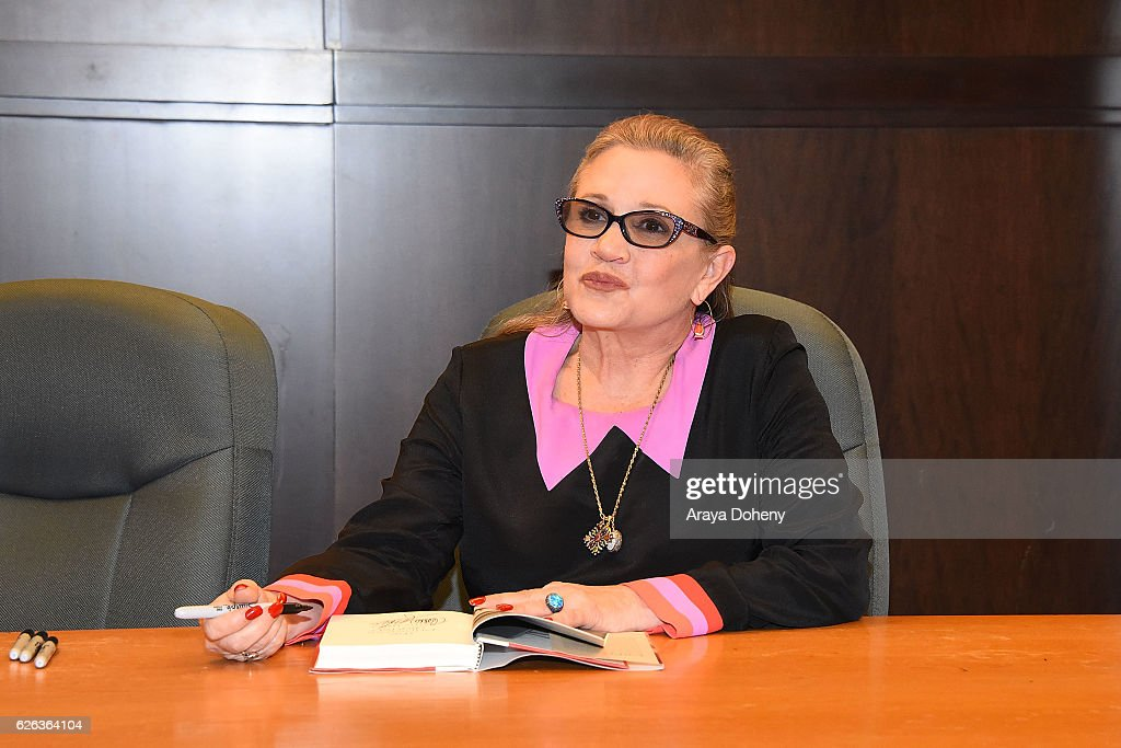 http://media.gettyimages.com/photos/carrie-fisher-signs-copies-of-her-new-book-the-princess-diarist-at-picture-id626364104?k=6&m=626364104&s=594x594&w=0&h=QZCXu5nwWTzhlROTqrFJrGXSEaE8vVV7l_vLnzTpAUw=