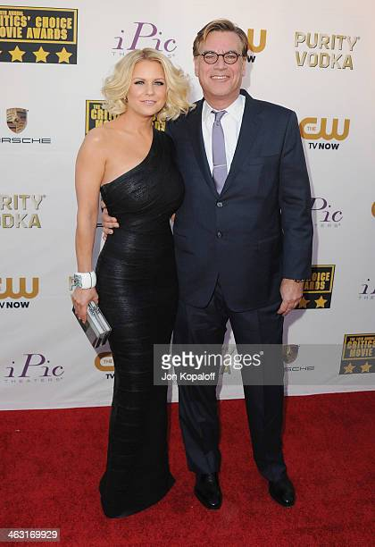 Carrie Keagan and writer Aaron Sorkin arrive at the 19th Annual Critics' Choice Movie Awards at Barker Hangar on January 16 2014 in Santa Monica...