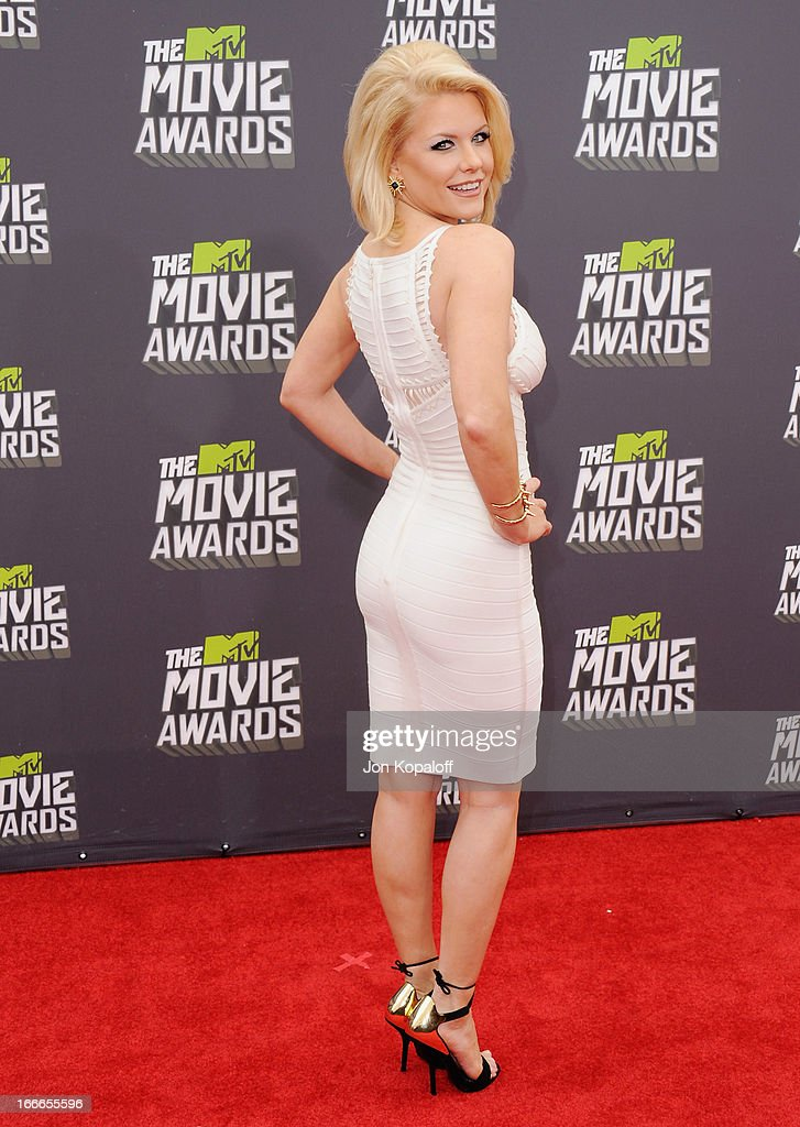 Carrie Keagan arrives at the 2013 MTV Movie Awards at Sony Pictures Studios on April 14, 2013 in Culver City, California.
