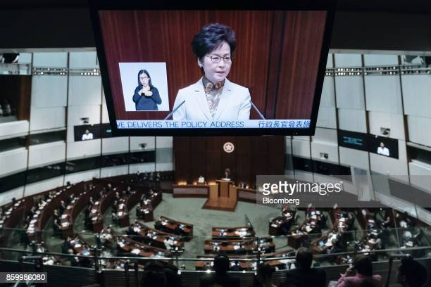 Carrie Lam Hong Kong's chief executive is displayed on a screen while speaking during a policy address in the chamber of the Legislative Council in...